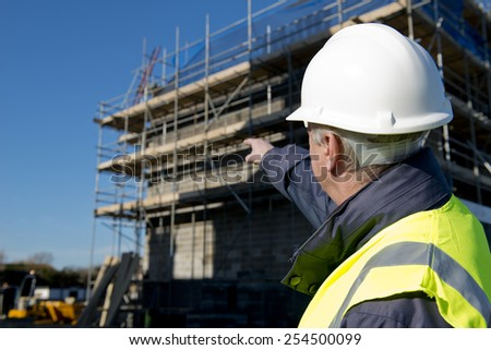 Civil Engineer With Construction Site In Background. - stock photo