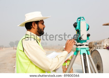 civil engineer working at a construction site - stock photo