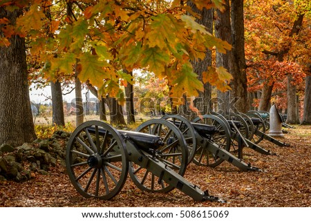 Civil War Artillery -  horizontal color image of line of Civil War cannons along stone wall on the Gettysburg Battlefield in autumn.