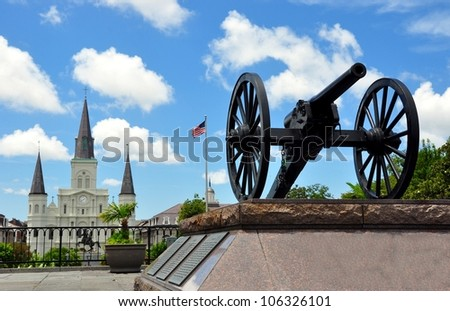 Civil War Cannon With Jackson Square And Saint Louis Cathedral In Background, French Quarter, New Orleans, Louisiana - stock photo