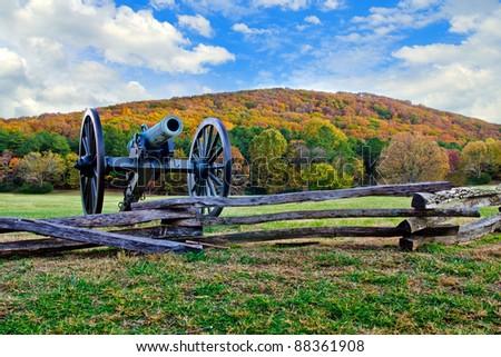 Civil War era cannon overlooks Kennesaw Mountain National Battlefield Park during fall or autumn - stock photo