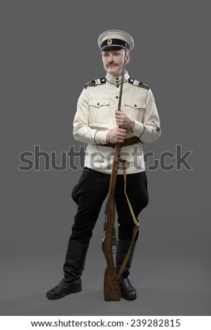 Civil War in Russia, Russian Civil War 1918-1922, White Guard, Trooper of 1st General Markov (Markoff) Officers Regiment. Isolated on grey background. Retro costume. - stock photo