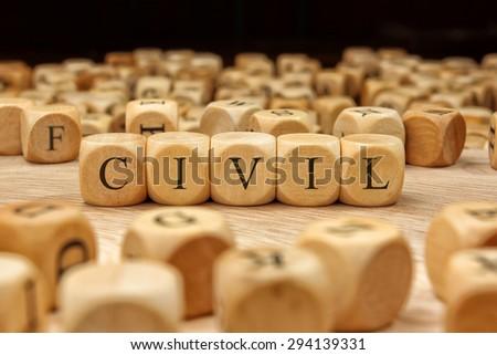 CIVIL word written on wood block - stock photo