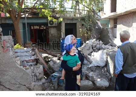 CIZRE, SIRNAK-SEPTEMBER 18: The eight-day-long curfew has left many buildings and vehicles seriously damaged in Cizre on September 14, 2015. The Photo Taken, September 18, 2015. - stock photo
