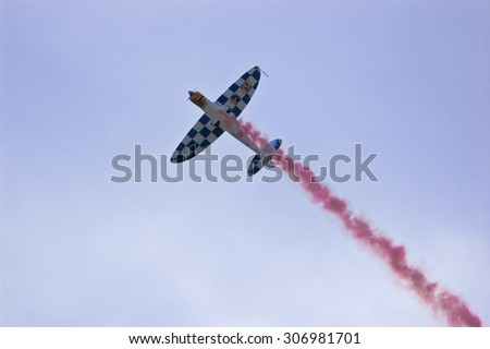 Clacton-on-sea, Essex, England UK: 2 August 2015                                                                    P 51 Mustang with pink smoke at the auuual air show, England UK. - stock photo