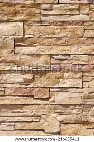 Cladding tiles imitating stones in sunny day  - stock photo