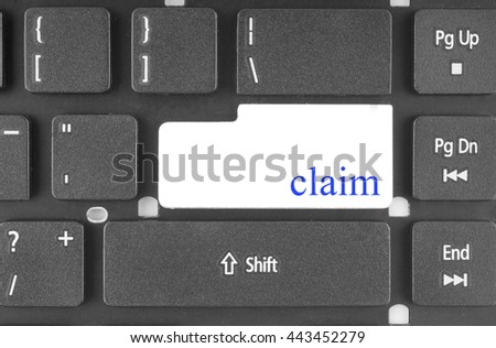 Claim Concept. Claim - Modern Keyboard Concept. Hand Touching Claim Keypad. Hand Finger Press Claim Key. Claim Concept - Modern Laptop Keyboard with Claim Key.                                - stock photo