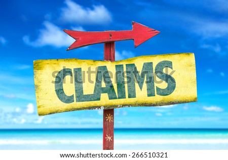 Claims sign with beach background - stock photo