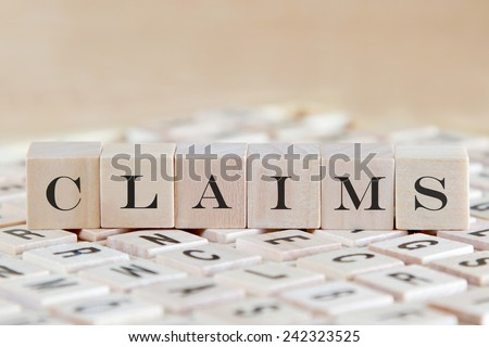 claims word on wooden cube - stock photo