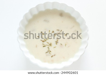 Clam chowder and dried thymus - stock photo