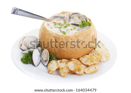 Clam chowder soup in bread bowl isolated on a white background. - stock photo