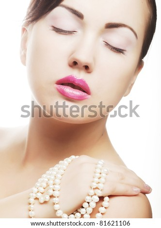 clamor young woman with pearl - stock photo