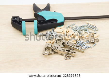 Clamp carpentry on the chipboard - stock photo