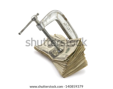 Clamp putting pressure on American Money. - stock photo