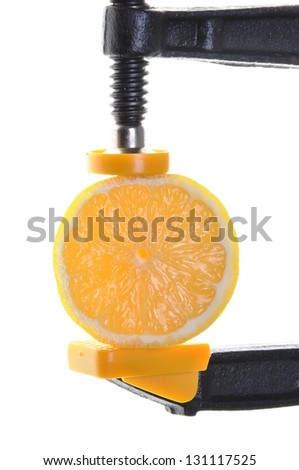 Clamp with a juicy half lemon isolated on white background - stock photo
