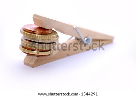 Clamp with coins - stock photo