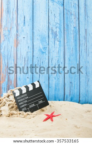 Clapboard from movie at the beach - stock photo
