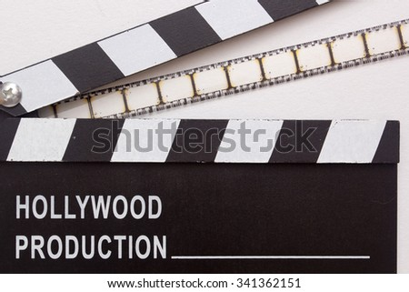 Clapper for the film industry and film. - stock photo