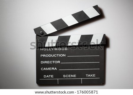 Clapperboard cinema on white - stock photo