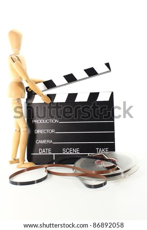 clapperboard with screen roll and wooden doll on a white background - stock photo
