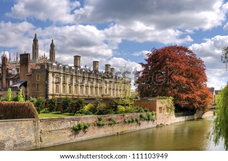 Clare College, Cambridge University, England Scenic view of old buildings in city of Cambridge with river in foreground, spring scene, England. - stock photo