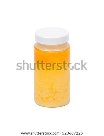Clarified butter ghee in plastic jar isolated on white background