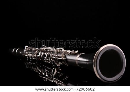 Clarinet isolated on black - stock photo
