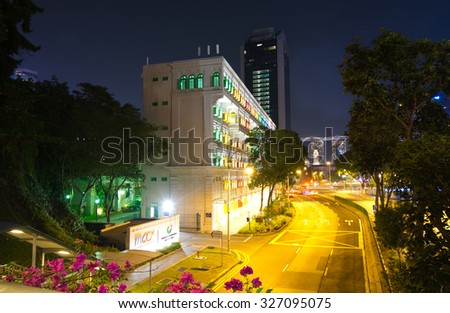 CLARKE QUAY, SINGAPORE - AUGUST 23: Night view of a street at Clarke Quay in river valley road Singapore On August 23, 2015.Clarke quay is a historical riverside quay located at the Singapore river - stock photo