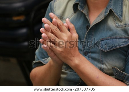 Clasped hands of man - stock photo