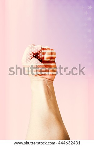 Class Man Riot US War Joy Labor Force Team Win UP Hand Power Blur Blue Body Fist Male Stars USA Flag Red Sign Fight White Pride United Human Symbol People Shape Proud Couple Happy Focus Rebel Maech - stock photo