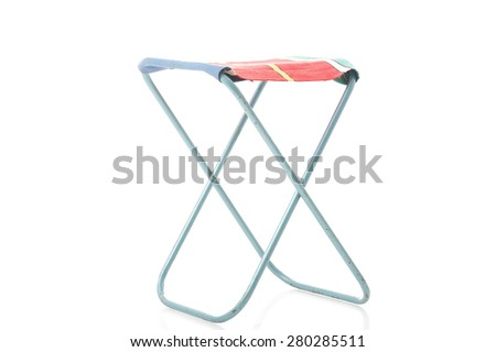 Class metal frame portable folding stool with a canvas or textile seat for picnics and camping viewed unfolded at an oblique angle isolated on white