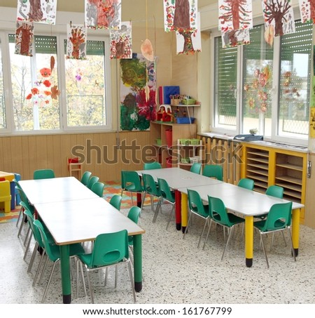 class of a nursery with drawings of children hanging from the ceiling - stock photo