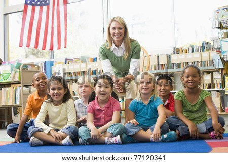 Class portrait with teacher - stock photo