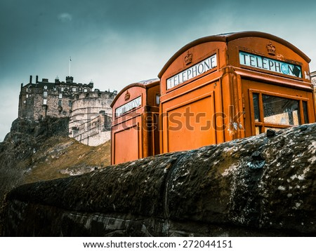 Class Red British Phoneboxes In Front Of Edinburgh Castle - stock photo