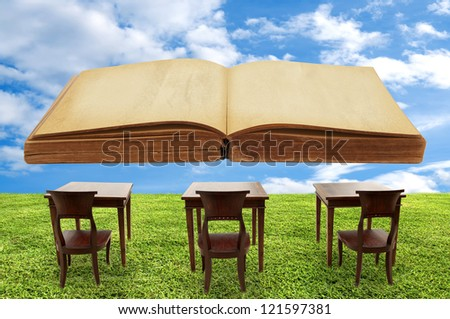 Class room student outdoor and a big book - stock photo