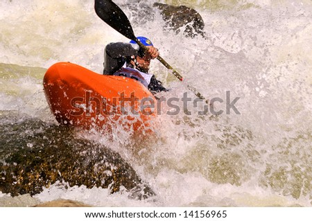 Class V whitewater kayak competitor on the Pine Creek section of the Arkansas River - stock photo