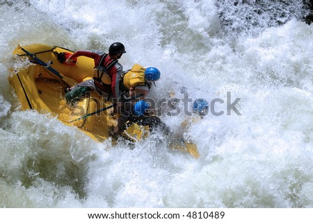 class V whitewater rapid with raft hitting the bottom of a 10' drop on the colorado river in gore canyon - stock photo
