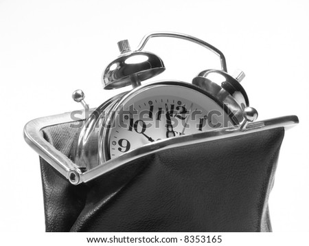 classic alarm clock in old style purse time is money concept
