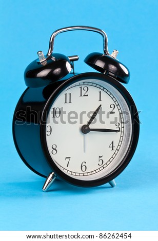 Classic alarm clock on a blue background