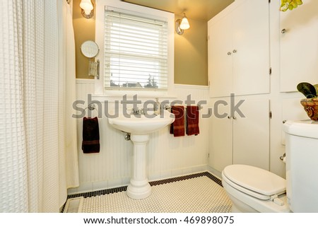 Classic American bathroom interior in white tones with white sink and toilet. Northwest, USA