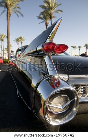 Classic American Car with cool chrome tail fin - stock photo