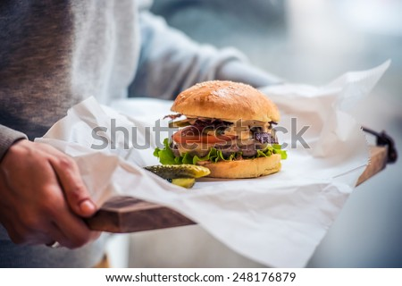 Classic american cheese burger on white paper - stock photo
