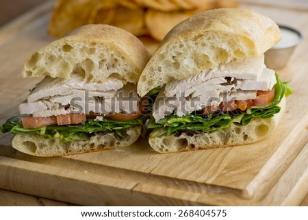 Classic American Chicken Sandwich with Lettuce & Tomato - stock photo