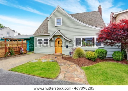 Classic American house exterior with nice landscape desing. Curb appeal. Northwest, USA