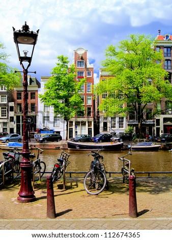 Classic Amsterdam canal scene, Netherlands - stock photo