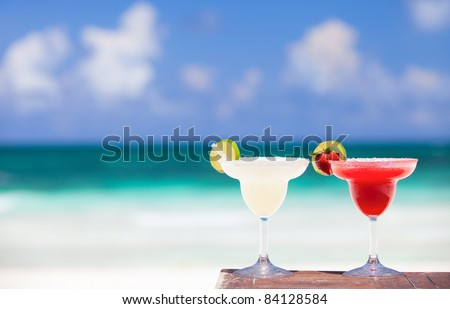 Classic and strawberry margarita cocktails at Mexican beach - stock photo