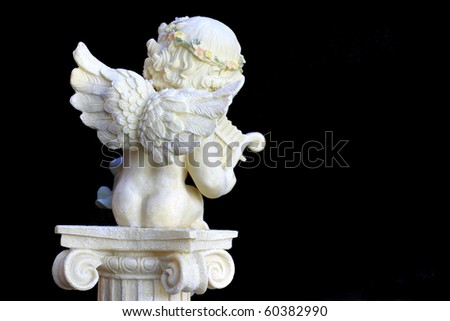 Classic angel statue playing harp in morning light - stock photo