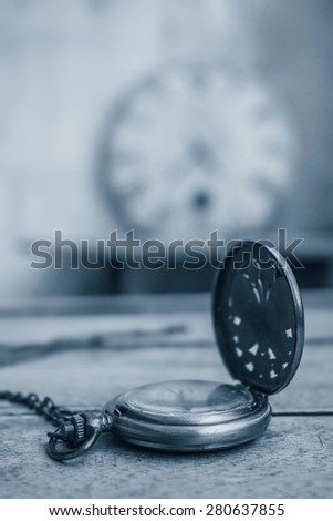 Classic antique clock on the old wooden - stock photo