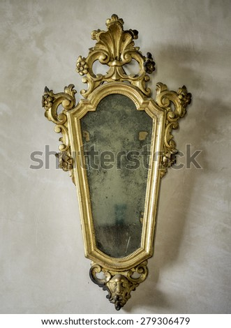 classic antique mirror with gilded frame engraved - stock photo
