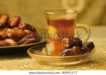 Classic arabic teacups and dates. - stock photo